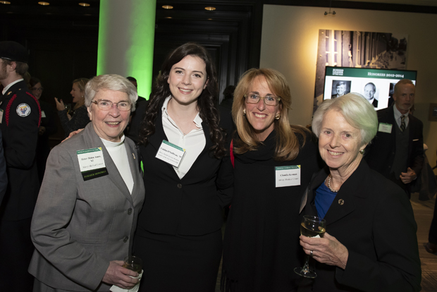 From left, Sister Helen Amos, executive chair of the board of trustees of Mercy Health Services; Caitlin O'Sullivan, a student at Loyola University Maryland; Claudia Keenan, senior vice president of Mercy Medical Center; and Sister Karen McNally, chief administrative officer of Mercy Medical Center – Stella Maris, enjoy the evening at the Renaissance Harborplace Hotel in Baltimore. (Photo by Larry Canner Photography)