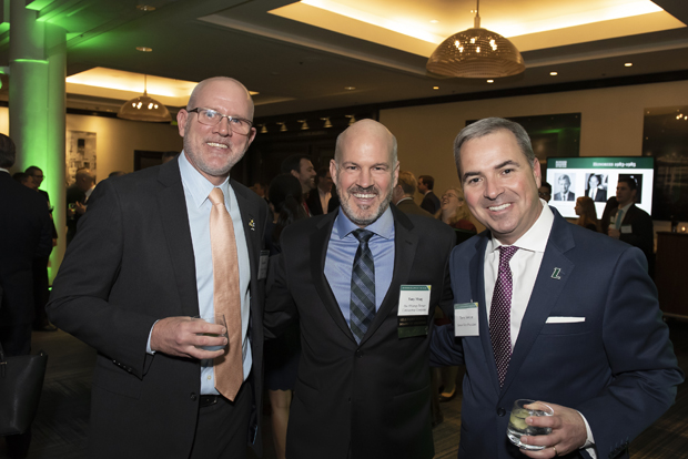 From left, John Busse, director of corporate internship program with Cristo Rey Jesuit High School; Anthony Moag, CEO of Whiting-Turner Contracting Company; and Terrence Sawyer, senior vice president at Loyola University Maryland, were on hand for the Sellinger School of Business and Management's 2018 Business Leader of the Year celebration. (Photo by Larry Canner Photography)
