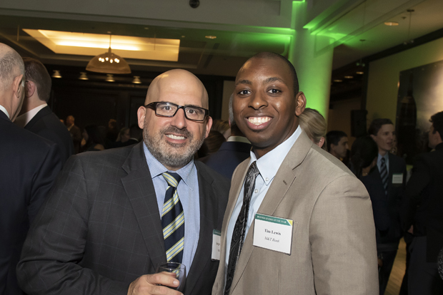Augie Chiasera, left, a regional president with M&T Bank, speaks with colleague Tim Lewis, vice president of digital marketing. (Photo by Larry Canner Photography)