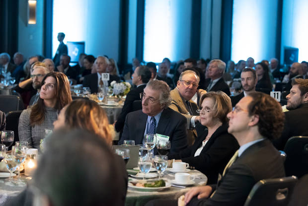 Guests at the Renaissance Harborplace Hotel in Baltimore listens to the program during the Sellinger School of Business and Management's 2018 Business Leader of the Year celebration. (Photo by Larry Canner Photography)
