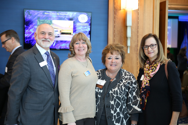From left, Eric Rebbert, president of ETR Consulting Group, Inc., Dawn Hamilton, senior vice president of member services with Freedom Federal Credit Union; Patrice Ricciardi, director of business development with Freedom Federal Credit Union; and Carolyn Evans, a partner with Sengstacke & Evans LLC, attended the Harford County State of the County luncheon. (Photo by Kate Rodriguez)