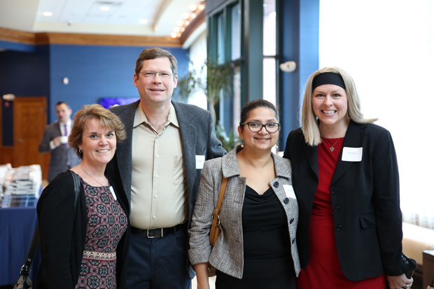 From left, Barbara Chandler, of MedStar Georgetown Cancer Institute; Ed Belsinger; Shweta Kurian, MD, of MedStar Georgetown Cancer Institute; and Melissa Belsinger, pose for a photo during the State of the County event. (Photo by Kate Rodriguez)