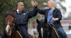 FILE - In this Feb. 13, 2018, file photo, New Orleans Mayor Mitch Landrieu, right, and chief of police Michael Harrison ride on horseback at the start of the Krewe of Zulu parade on Mardi Gras day in New Orleans. A day after her first choice withdrew his candidacy, Baltimore's mayor on Tuesday, Jan. 8, 2019, picked New Orleans Police Superintendent Michael Harrison as her nominee to lead the city's troubled force. (AP Photo/Gerald Herbert, File)
