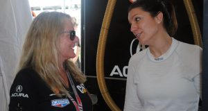 Team owner Jackie Heinricher, left, chats with Katherine Legge, of England, during a test session at Daytona International Speedway in Daytona Beach, Fla., Friday, Jan. 4, 2019. Legge is part of an all-female-driver team racing in the Rolex 24 at Daytona later this month. (AP Photo/Mark Long)