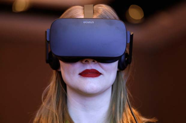 In this Jan. 4, 2017, photo a woman participates in a virtual realty presentation during an Intel news conference before CES International in Las Vegas. The weeklong event is one of the world's largest trade shows and where many tech companies and startups go to show off their latest gadgets and more than 180,000 people are expected to attend CES this year. It is against this background that a growing number of people inside and out of the tech industry are urging organizers of events like CES to ensure that their roster of speakers features a broad array of people, diverse in gender, race as well as in their thinking.  (AP Photo/John Locher, File)