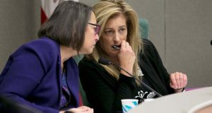 In this Nov. 28, 2017, file photo, Assemblywoman Laura Friedman, D-Glendale, left, confers with Assemblywoman Marie Waldron, R-Escondido, during a hearing in Sacramento, Calif. State legislatures across the country are convening this year with at least 17 new women in top leadership roles, after a record-setting election for female candidates. California Assemblywoman Waldron, a Republican who is the chamber's new minority leader, said it's important to have female leaders because they bring a different perspective to the legislative process than men. (AP Photo/Rich Pedroncelli, File)