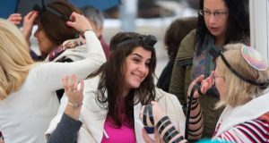 In this Feb. 7, 2016, file photo, Israeli women wear Tefillin, also known as Phylacteries - small leather boxes containing religious texts usually worn by Jewish men, at the Western Wall, the holiest site where Jews can pray in Jerusalem's Old City. (AP Photo/Sebastian Scheiner, File)