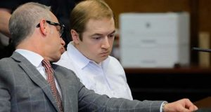 FILE - In a Wednesday Jan. 23, 2019 file photo, James Jackson, right, confers with his lawyer during a hearing in criminal court, in New York. Jackson, a white supremacist who killed a black man with a sword as part of an attack that authorities said was intended to incite a race war was sentenced Wednesday, Feb. 13, 2019 to life in prison without parole. (AP Photo/Bebeto Matthews, File)