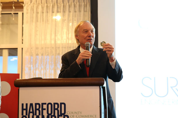 Maryland Comptroller Peter Franchot gets ready to present a token to Deborah Williams, the Harford Chamber Board chair and vice president of commercial lending at APG Federal Credit Union. (Photo by Kate Rodriguez)