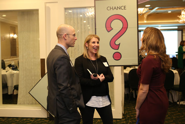Mandy Diamond, center, a principal consultant with Blue Zone Thinking, answers a question from another of the guests during the Harford County Chamber of Commerce's annual dinner at the Maryland Golf & Country Club. (Photo by Kate Rodriguez)