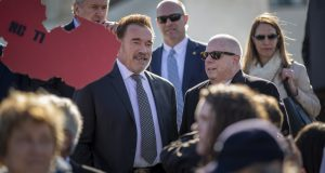 """Former California Gov. Arnold Schwarzenegger, left, and Maryland Gov. Larry Hogan, attend a rally for """"Fair Maps"""" at the Supreme Court in Washington Tuesday. (AP photo/Carolyn Kaster)"""