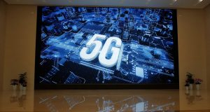 A 5G logo is displayed on a screen outside the showroom at Huawei campus in Shenzhen city, China's Guangdong province, Wednesday, March 6, 2019. Huawei Technologies Co. is one of the world's biggest supplier of telecommunications equipment. (AP Photo/Kin Cheung)
