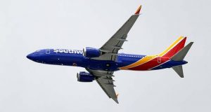 A Southwest Airlines Boeing 737 MAX 8 jet flies over Mesa, Ariz., en route to Phoenix's Sky Harbor International Airport Wednesday afternoon, March 13, 2019. President Donald Trump said Wednesday that the U.S. is issuing an emergency order grounding all Boeing 737 Max 8 and Max 9 aircraft in the wake of the crash of an Ethiopian Airliner that killed 157 people. (AP Photo/Elaine Thompson)