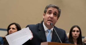 FILE - In this Wednesday, Feb. 27, 2019 file photo, Michael Cohen, President Donald Trump's former personal lawyer, reads an opening statement as he testifies before the House Oversight and Reform Committee on Capitol Hill in Washington. Cohen says he's cooperating with federal prosecutors in New York and hopes to receive a so-called Rule 35 motion from prosecutors that would reduce the time he is to spend in prison. (AP Photo/J. Scott Applewhite, File)