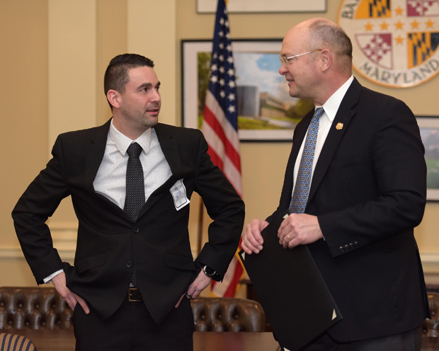 Daniel Zubrowski, left, a teacher at Havre de Grace Elementary School and winner of a 2019 Financial Education and Capability Award, speaks with state Sen. Bob Cassilly, R-Harford County during the sixth annual Financial Education and Capability Awards. (Photo by Thomas Nappi)