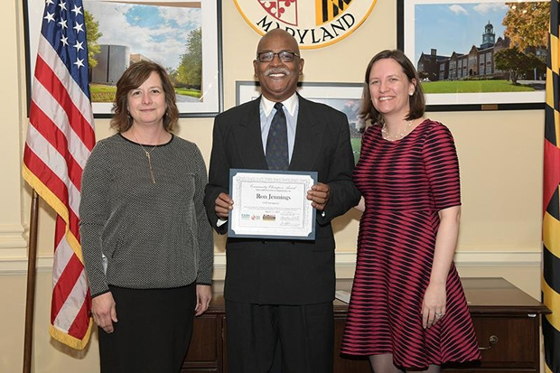 Ron Jennings, center, chair of CAFÉ Montgomery, accepts his award with Sue Rogan, left, the director of strategic partnerships with CASH Campaign of Maryland, and Robin McKinney, co-founder and CEO of CASH Campaign of Maryland. (Photo by Thomas Nappi)
