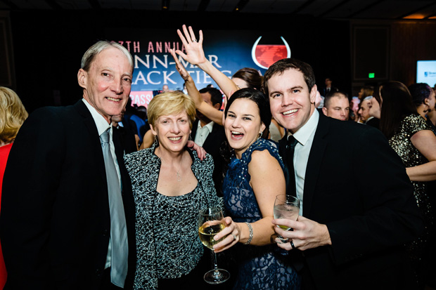 From left, Craig Ashway and Debbie Ashway enjoy a drink with Casey Herrmann and Garrett Herrmann during the black-tie event. (Photo by SMJ Photography)