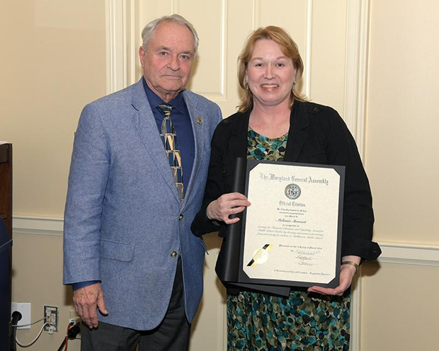 Middletown Middle School teacher Melanie Stuart is joined by Del. Barrie S. Ciliberti, R-Frederick and Carroll counties as she displays her recognition during the sixth annual Financial Education and Capability Awards. (Photo by Thomas Nappi)