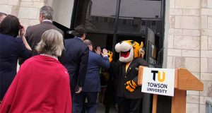 Towson University's tiger mascot high fives guests heading into to the former Maryland National Guard Armory on Friday in downtown Towson. The university singed a lease for the historic building, and plans to use it as a hybrid co-working, business incubation and community engagement center.