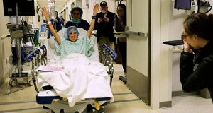 "In this image made from video provided by Johns Hopkins Medicine, Nina Martinez of Atlanta is wheeled into a Baltimore operating room to become who is thought to be the world's first kidney transplant living donor with HIV, on Monday, March 25, 2019. Martinez, 35, donated a kidney to an HIV-positive stranger, saying she ""wanted to make a difference in somebody else's life"" and counter the stigma that too often still surrounds HIV infection. (Johns Hopkins Medicine via AP)"