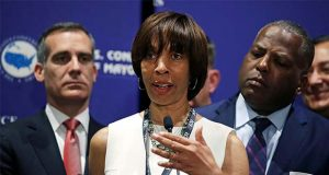 FILE - In this June 8, 2018 file photo, Baltimore Mayor Catherine Pugh addresses a gathering during the annual meeting of the U.S. Conference of Mayors in Boston. Pugh on Monday, March 18, 2019, stepped down from the University of Maryland Medical System's board of directors, days after it came to light that the hospital network had for years purchased her self-published children's books. Board positions are unpaid, but The Baltimore Sun reported last week that around a third of the board received compensation through the UMMS network's contracts with their businesses. The newspaper revealed that Pugh failed to fully disclose a $500,000 business relationship she began with the 11-hospital network in 2011.(AP Photo/Charles Krupa, File)