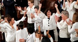FILE - In this Feb. 5, 2019 file photo, women members of Congress cheer after President Donald Trump acknowledges more women in Congress during his State of the Union address to a joint session of Congress on Capitol Hill in Washington. A new survey finds acceptance of women in American politics and the workforce is at a record high. (AP Photo/J. Scott Applewhite)