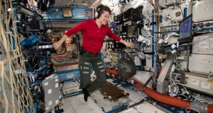 In this Jan. 18, 2019 photo made available by NASA, Flight Engineer Anne McClain looks at a laptop computer screen inside the U.S. Destiny laboratory module of the International Space Station. McClain was supposed to participate in a spacewalk Friday, March 29, 2019 with newly arrived Christina Koch. But McClain pulled herself from the lineup because there's not enough time to get two mediums suits ready. Koch will go out with a male crewmate. (NASA via AP)