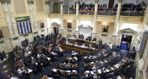 Delegates work in the Maryland House of Delegates chamber in Annapolis Monday, the final day of the state's 2019 legislative session. (AP Photo/Steve Ruark)