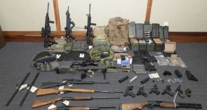 This image provided by the U.S. District Court in Maryland shows a photo of firearms and ammunition that was in the motion for detention pending trial in the case against Christopher Paul Hasson.  The Coast Guard officer accused of stockpiling guns and compiling a hit list of prominent Democrats and network TV journalists is seeking his release from federal custody since prosecutors haven't charged him with any terrorism-related offenses. Hasson has remained in custody since his Feb. 15, 2019 arrest and subsequent indictment in Maryland on firearms and drug charges.  (U.S. District Court via AP, File, File)
