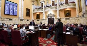 Sen. Paul Pinsky, D-Prince George's County, standing left, speaks in the Maryland Senate chamber in Annapolis, Md., Monday, April 8, 2019, the final day of the state's 2019 legislative session. (AP Photo/Steve Ruark)