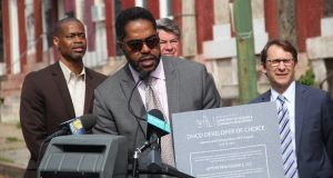 Dean S. Harrison, principal of Upton Renaissance LLC, holds a certificate from the city showing the firm was selected to build 38 homes as part of revitalization efforts in west Baltimore's Upton neighborhood. (Adam Bednar)