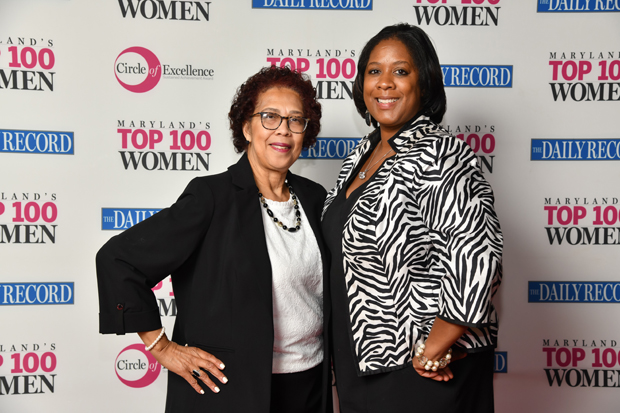 2019 Top 100 Women winner Rev. Reba R. Fitchett, of One Church One Child of Maryland, right, poses for a photo with Tenyo Pearl, campus director with the Coppin State University Nonprofit Leadership Alliance and a 2018 Top 100 Women winner. (Photo by Maximilian Franz)