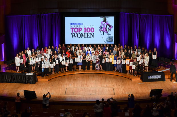 Winners of The Daily Record's Top 100 Women award pose for a group photo on stage at the Joseph Meyerhoff Symphony Hall in Baltimore. (Photo by Maximilian Franz)