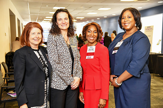 From left, Ruth Lenrow, chair of the board of trustees at Goucher College; Suzanne Fischer-Huettner, publisher of The Daily Record; Debra Bright, Associate Dean of Student Affairs at Montgomery College; and Tenyo Pearl, campus director of the Coppin State University Nonprofit Leadership Alliance, pause for a photo during the 2019 Women's Leadership Summit. (Photo by Maximillian Franz)