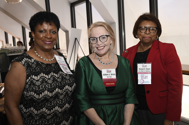 From left, 2019 Top 100 Women winner Kathleen A. Birrane, a partner at law firm DLA Piper, stands with previous Circle of Excellence winners retired chief audit executive Gwendolyn Skillern and Margaret Hayes, co-founder of A Bridge to Academic Excellence with the University of Maryland School of Pharmacy. (Photo by Steve Ruark)