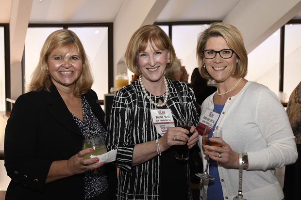Mary Makowske, a registered investment advisor with Jemma Investment Advisors LLC, Circle of Excellence member Bonnie Stein, co-founder, president and CEO of Jemma Financial Services and 2019 Top 100 Women winner Danielle Stager Zoller, Esq., a member with law firm Gordon Feinblatt LLC, chat during the reception. (Photo by Steve Ruark)