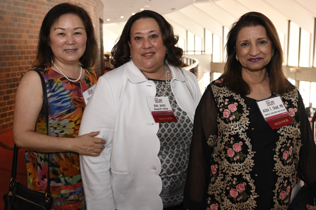 2019 Top 100 Women winners Song Hutchins, founder, president and CEO of Asian-American Homeownership Counseling Inc.; Kim Jones, executive director of Nonprofit Village; and Aziza T. Shad, MD, chair of LifeBridge Health's Samelson Children's Hospital at Sinai Hospital, pose for a photo. (Photo by Steve Ruark)