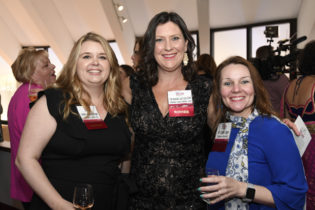 2019 Top 100 Women winners Jamie Holmes-Kriger, associate registrar with Salisbury University; the Hon. Juliet Grace Fisher, a judge in Baltimore County Orphans' Court; and Dr. Chrys Egan, a professor at Salisbury University, pose for a photo at the reception. (Photo by Steve Ruark)