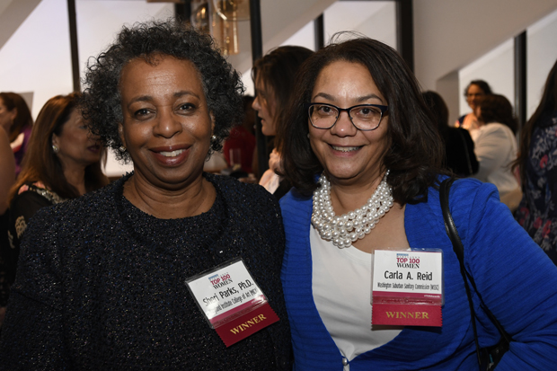2019 Top 100 Women winners Sheri Parks, Ph.D., vice president of strategic services with Maryland Institute College of Art, and Carla A. Reid, general manager of the Washington Suburban Sanitary Commission, pose for a photo. (Photo by Steve Ruark)