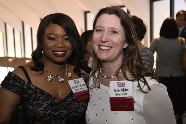 2019 Top 100 Women winners Angela D. Wharton, executive director of Phynyx Ministries, and Katie Allston, executive director of Marian House, take a break during the event. (Photo by Steve Ruark)