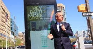 Pete Scantland, CEO of IKE Smart Cities, in front of one of the kiosks operating in downtown Baltimore. (Adam Bednar)