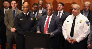 """Bernard C. """"Jack"""" Young, acting mayor of Baltimore, speaks on Tuesday, flanked by …. including Baltimore Fire Chief Niles R. Ford, front left, and Police Commissioner Michael Harrison. (The Daily Record / Adam Bednar)"""