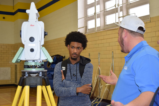 Joshua Hood of Century Engineering chats with a student about geographic information system mapping. (Photo courtesy of Urban Alliance)