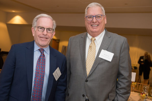 Michael O. Scherr, left, president and CEO of EMJAY Engineering and Construction, and Al Saxon, senior vice president of sales and marketing for Vision Technologies, attended the recognition breakfast. (Photo by Jennifer McMenamin)