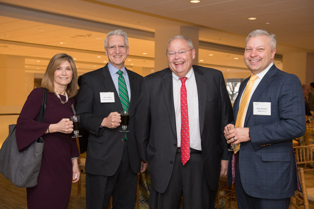 From left, Barbara Anderson, general sales manager of WBAL-TV; Glenn Ross, a managing partner and owner of Marquette Associates investment consulting firm; Thomas R. Mullen, president and CEO of Mercy Health Services; and Dan Joerres, president and general manager of WBAL-TV, pose for a photo. (Photo by Jennifer McMenamin)