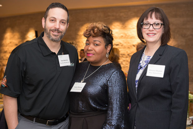 From left, Sam Runfola, marketing manager and sports medical director of NovaCare Rehabilitation; Lakiah Henson, business development manager of NovaCare Rehabilitation; and Eleanor Hajduk, a manager at the Mercy Health Foundation, enjoy their time at the recognition breakfast. (Photo by Jennifer McMenamin)