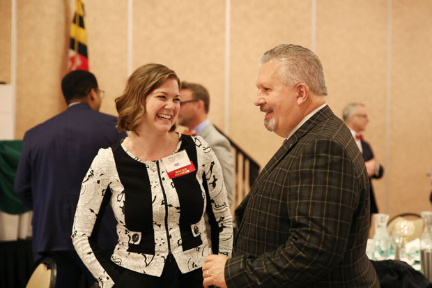 Jillian Lader, manager of communications with Harford County Public Schools, chats with Mark Dardozzi, co-owner and vice president of Richlin Catering and Events Center. (Photo by Kate Rodriguez)