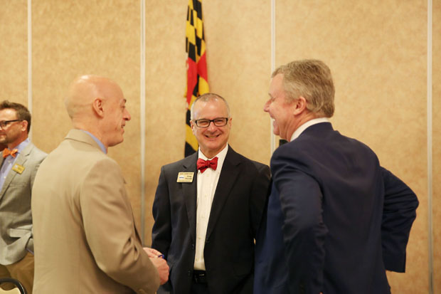 From left, Rod Bourn, founder of Down, Set, Lead!; Greg Pizzuto, executive director of Visit Harford; and Jay Ellenby, president of Safe Harbors Business Travel LLC, engage in conversation during the annual economic outlook breakfast. (Photo by Kate Rodriguez)