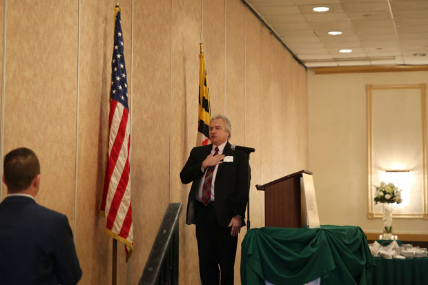 Bill Fritz, senior branch manager at M&T Bank recites the Pledge of Allegiance before the start of the Harford County Chamber of Commerce's economic outlook breakfast. (Photo by Kate Rodriguez)