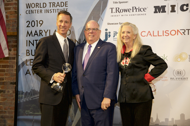 Arne Sorenson, left, the president and CEO of Marriott International, shows off his 2019 Governor's Award with Gov. Larry Hogan and Deb Kielty, CEO of the World Trade Center Institute. (Photo courtesy of the World Trade Center Institute)